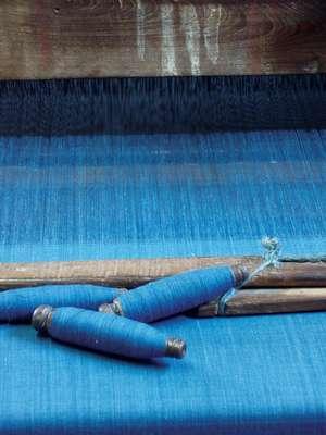 Bobbins of indigo-dyed yarn on the loom, Chennur, Andhra Pradesh.