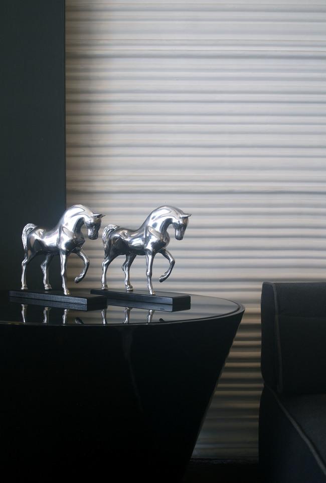 Horse on metal base