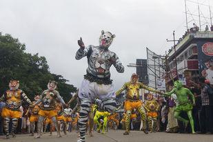 Pullikali Dance - Photograph by Sandipan Majumdar