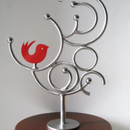 Title    sunrise 5    artist   romicon revola   medium   stainless steel   size   13 inches x 12 inches x 4 inches    year   2012
