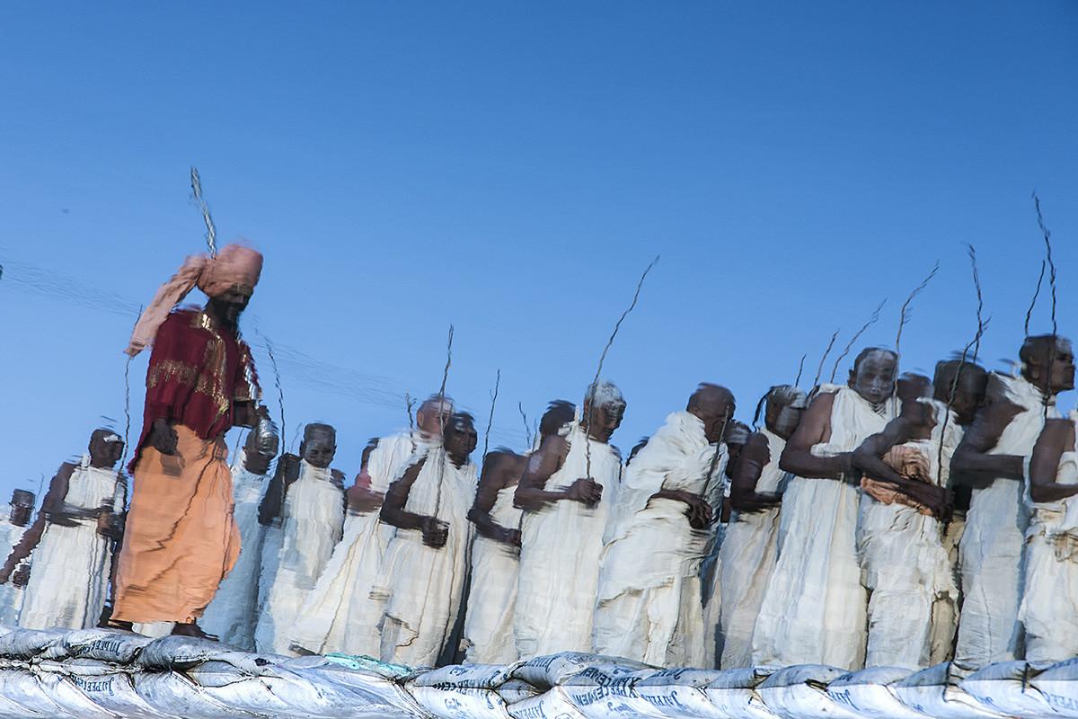Naga Sadhvis Of The Juna Akhara by Udit Kulshrestha, Image Photography, Digital Print on Canvas, Blue color