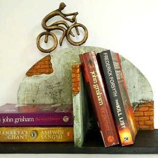 Cyclist on brick wall Bookend Book End By THE ART SPA