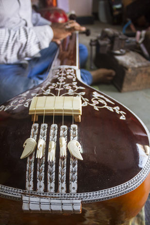 Giving final touches to the Tanpura by Ankit Agrawal, Image Photography, Digital Print on Archival Paper, Brown color