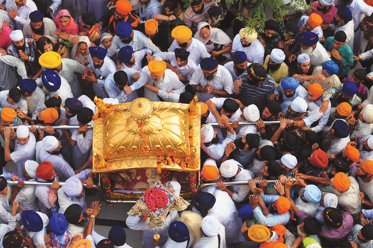 On the eve of Guru Nanaks birthday, the Guru Granth Saheb is taken around the parikrama in a procession. by Rupinder Khullar, Image Photography, Digital Print on Paper, Brown color