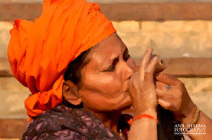 Glimpses of India-3 Women Naga Sadhu enjoying clay pipe. by Anil Sharma, Image Photography, Digital Print on Archival Paper, Brown color
